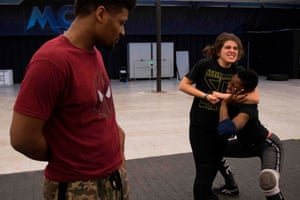 Months before becoming the youngest ever MCW female champion, Scott (far right) gets pointers from her boyfriend and professional wrestler Deion Epps as she practises with fellow female wrestler Aria Palmer during a class in Joppa, Maryland.