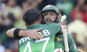 Pakistan's Imad Wasim and Wahab Riaz celebrate their team's three-wicket victory against Afghanistan at Headingley