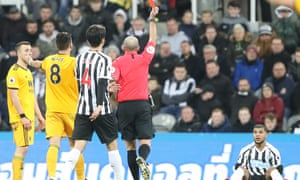 DeAndre Yedlin is dismissed by referee Mike Dean
