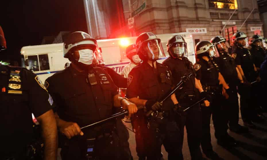 Police officers are seen during a protest against the death in Minneapolis police custody of George Floyd, in New York City at the weekend.