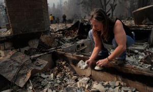 Erin Hillman, a member of the Karuk Tribe, looks at ceramics damaged in her home after the Slater fire in Happy Camp, California, on 30 September 2020.