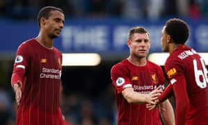 Joël Matip (left) and James Milner celebrate Liverpool's victory at Chelsea with Trent Alexander-Arnold.