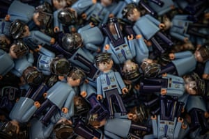 Nove Veseli, Czech Republic Toy policeman figurines named wearing face masks are prepared for packing at one of the production lines of the Efko-karton company. The company will donate a share of the sales for protection equipment for paramedics and emergency personnel