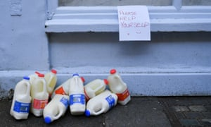Frozen milk on offer to the public outside a bakery in Bath after shops and businesses closed