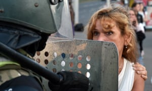 A woman confronts riot police during an opposition rally on Tuesday