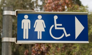 A sign directing people towards public toilets