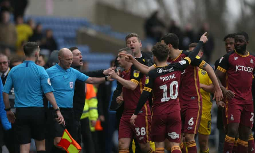 Bradford City players confront the referee amid late drama at Oxford.