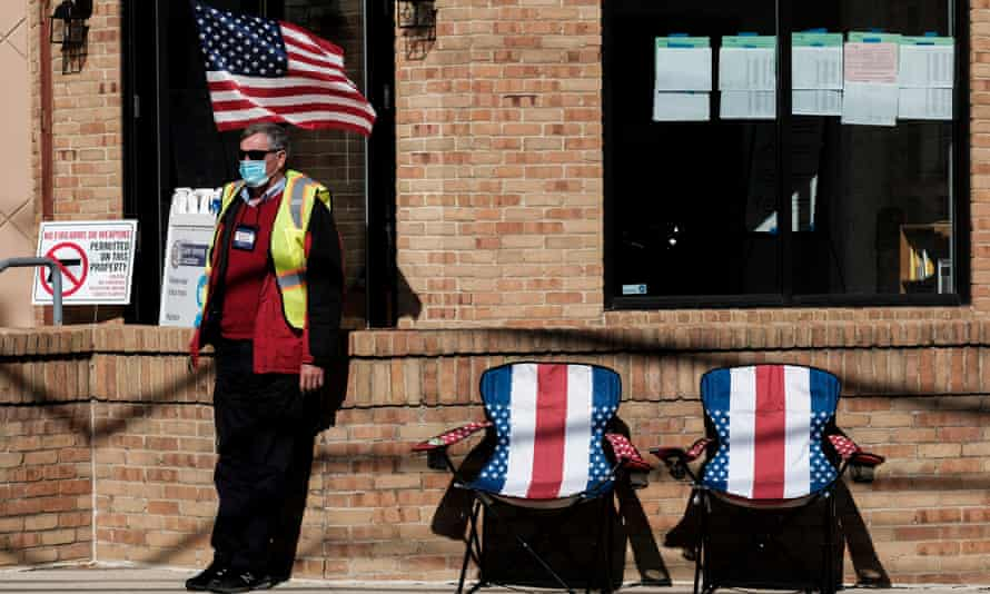 A poll worker sits outside and assists voters at a polling station in Columbus, Ohio, in November.