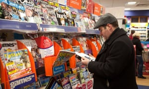 A man looking at magazines in WH Smith