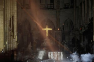 Smoke rises around the altar as the fire continues to burn into Tuesday