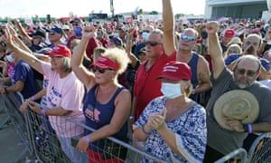 Supporters cheer for speakers at a campaign rally prior to the arrival President Donald Trump at the Orlando Sanford International Airport Monday, Oct. 12, 2020, in Sanford, Fla. (AP Photo/John Raoux)