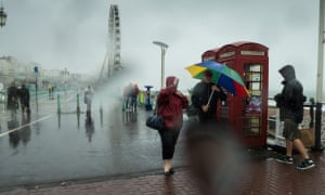 Rough August weather sets a challenge for walkers near Brighton Pier in 2014.