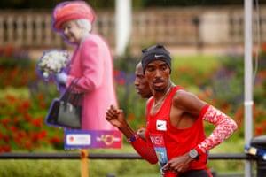 Mo Farah of runs as a pacer