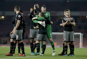 Forster hugs Clasie as they applaud their fans after winning 2-0.