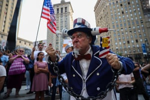 Demonstrators gather at a 'freedom rally' in New York to protest against Covid-19 vaccination mandates
