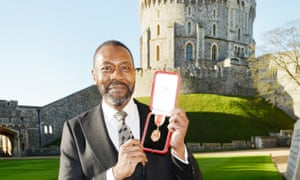 Sir Lenny Henry with his award after the investiture ceremony at Windsor Castle.