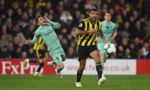 Troy Deeney (right) looks straight ahead after his elbow on Lucas Torreira.