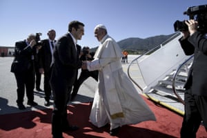 Pope Francis is greeted by Greek Prime Minister Alexis Tsipras as he arrives at Mytilene airport
