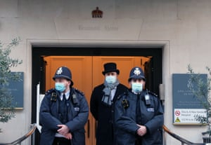 London, England Police officers and hospital security staff outside the King Edward VII hospital, where the Duke of Edinburgh, 99, was admitted on Tuesday night as a precaution after feeling unwell