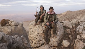 Newal, a fighter of the YJÊ, and Shêbo, a volunteer policeman for a Yazidi refugee camp in the Sinjar mountains.