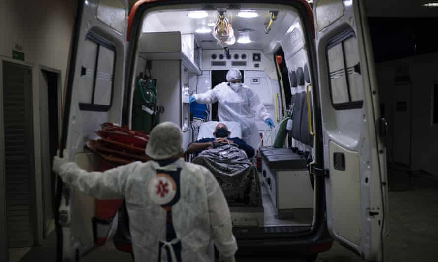 A Covid-19 patient is put in an ambulance
