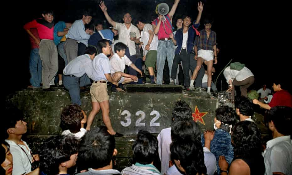 Protestors stand on a tank in the early hours of 4 June 1989, when China brutally cracked down on pro-democracy protestors in Tiananmen Square.