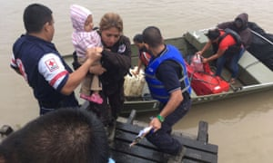 Red Cross members help people prepare to be evacuated as Otto approaches in Barra de Colorado, Costa Rica, on Wednesday.