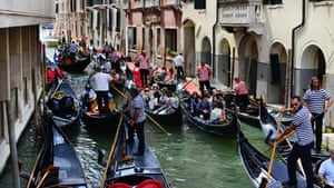 "Gondolas full of tourists in a ""traffic jam""."