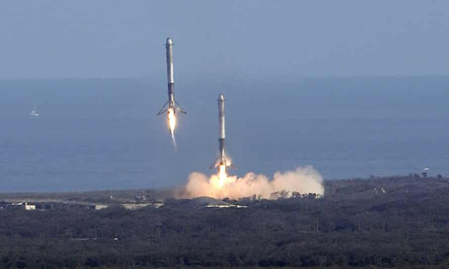 Two booster rockets from the Falcon 9 SpaceX heavy, return for a landing