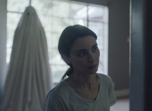 'Loitering on the edge of the frame like a piece of misplaced laundry': Casey Affleck haunts Rooney Mara in A Ghost Story.