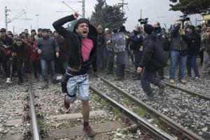Idomeni, Greece: Refugees and migrants break through a police cordon