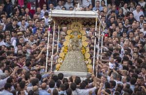 Pilgrims gather around the statue of the Rocío Virgin in El Rocio, Spain