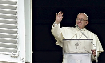 Pope Francis waves the faithful during his Sunday Angelus prayer in Saint Peter's Square at the Vatican.