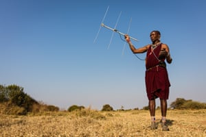 Maasai warrior Kamunu Saitoti scans the Kenyan rangelands for a signal from a number of lions that have been fitted with radio collars