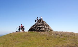 Kids sitting on top of Dunkery Beacon, Exmoor's highest point, Somerset