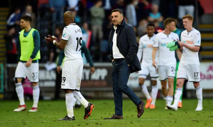 Swansea City manager Carlos Carvalhal and Andre Ayew look dejected after the match as they are relegated.