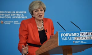 Theresa May comes under pressure at the launch of the Tory party's manifesto for Wales in Cardiff.
