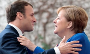 German chancellor Angela Merkel and French President Emmanuel Macron embracing