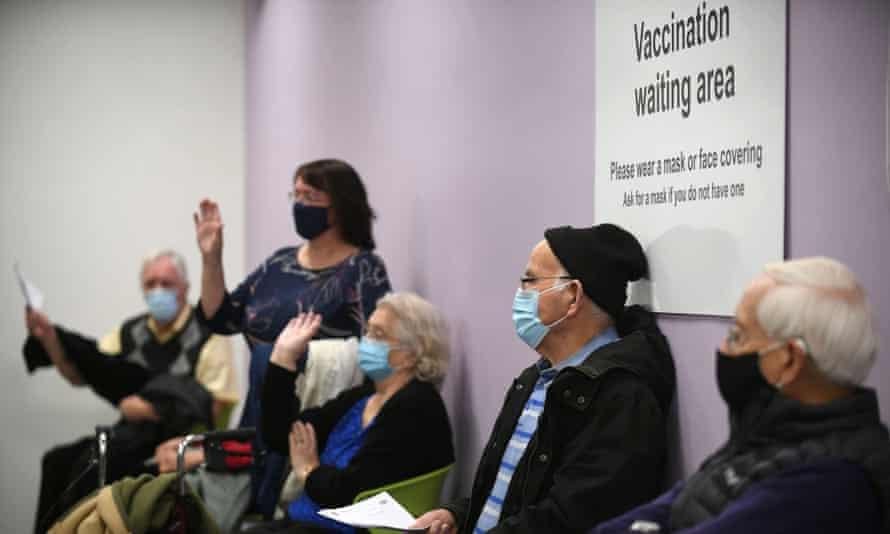 People wait to receive their Covid vaccine in Stevenage, Hertfordshire