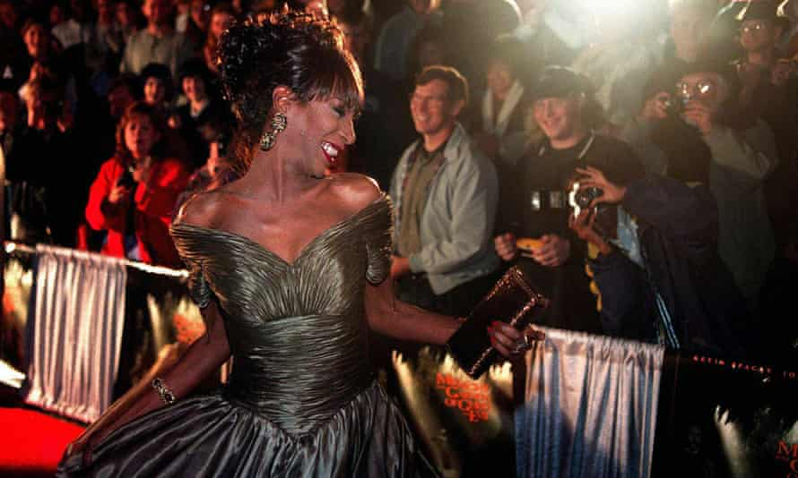 The Lady Chablis twirls for the crowd at the premier of Midnight in the Garden of Good and Evil.