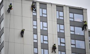 Specialists check the cladding on a building on the Chalcots estate in north London.