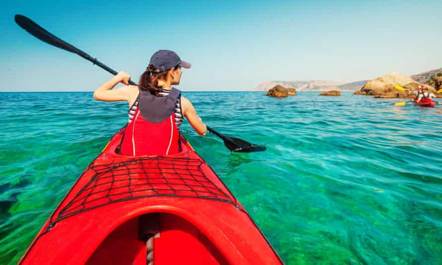 Sea kayaker on the water in Sardinia, Italy.