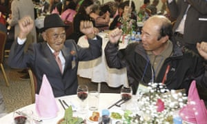 Oh Se In, 83 (left) and his son Oh Jang-kyun, 65, celebrate during the meeting at the North Korean resort on Tuesday