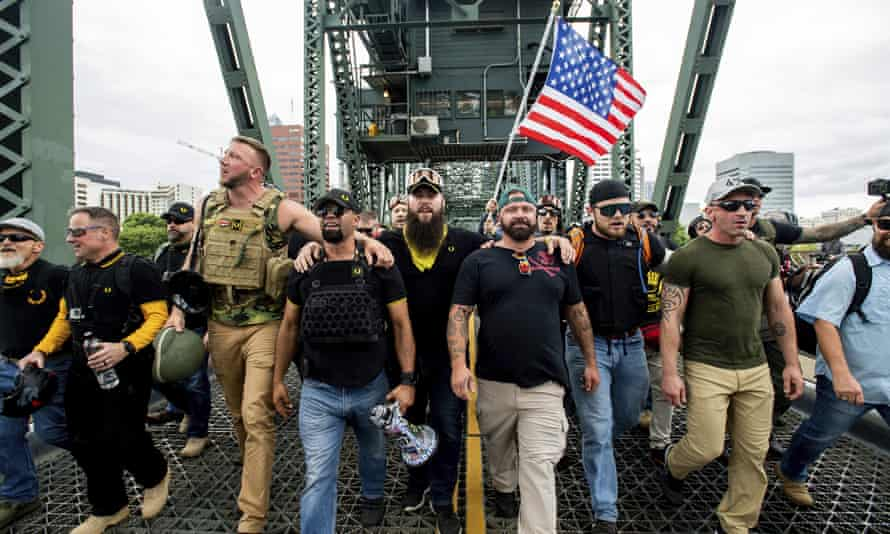 Members of the Proud Boys and other rightwing demonstrators march in Portland on 17 August 2019.