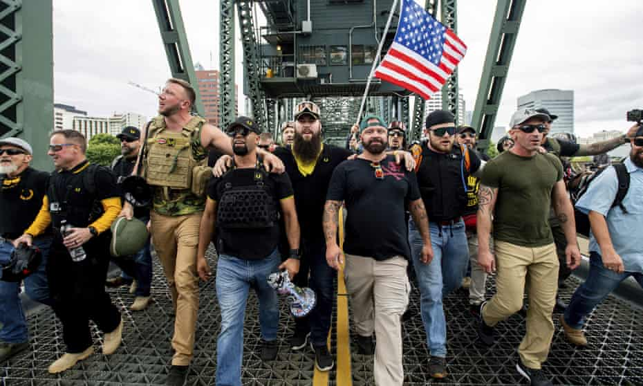 Members of the Proud Boys and other rightwing demonstrators march in Portland, Oregon in August.
