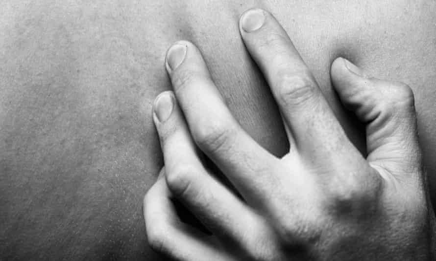 Man touching woman's back
