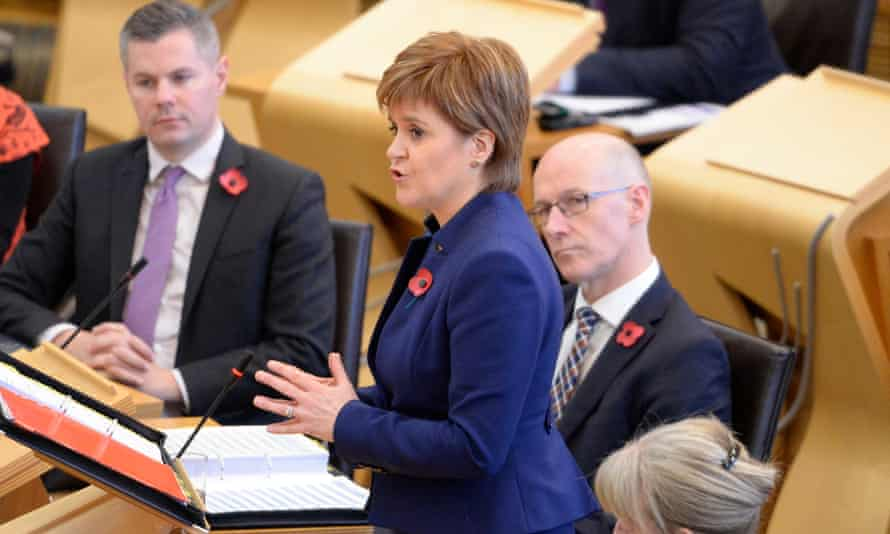 Nicola Sturgeon stands up to answer First Minister's Questions in the debating chamber of the Scottish parliament