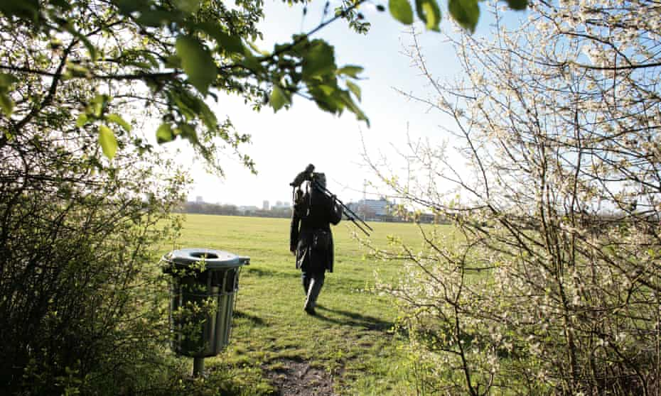 Birdwatcher on Wormwood Scrubs, west London