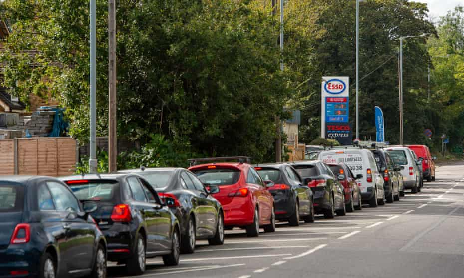 Queue of cars outside petrol station
