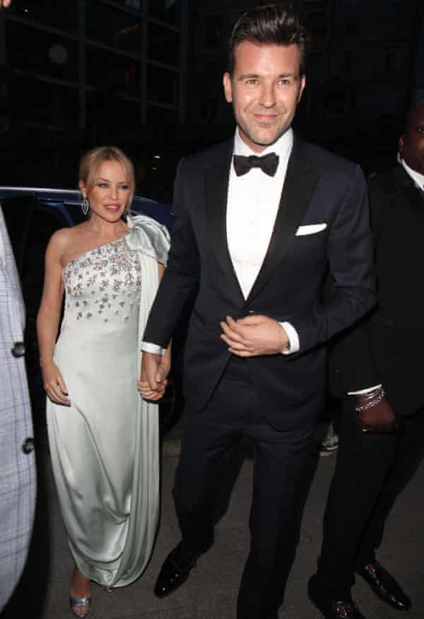 Kylie Minogue dressed in a silver gown, with her boyfriend, GQ creative director Paul Solomons, in black tie, in September 2019.